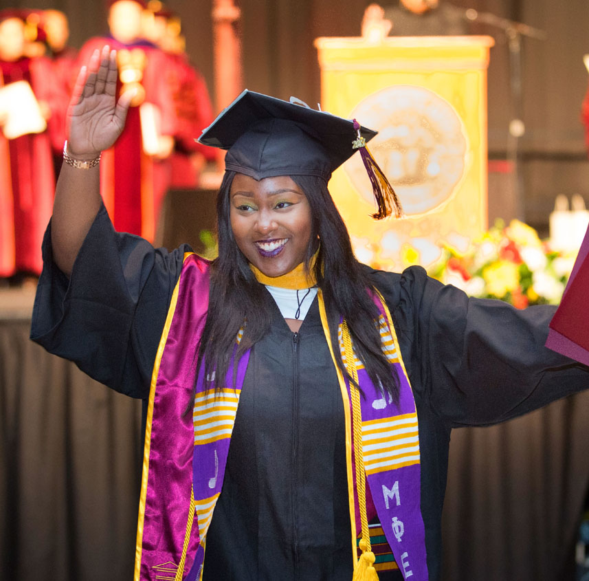 link to Baccalaureate and Commencement Arrival and Parking page, photo of graduate from 2017 Commencement ceremony, Dayton Convention Center.