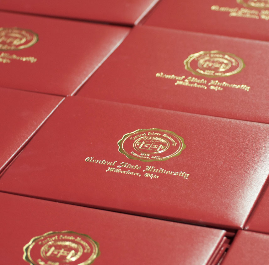 link to Baccalaureate and Commencement Speakers page, photo of CSU diplomas at the 2017 Commencement