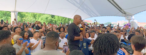 photo of Dave Chappelle speaking prior to the Gem City Shine Event. Photo: Jahan Culbreath